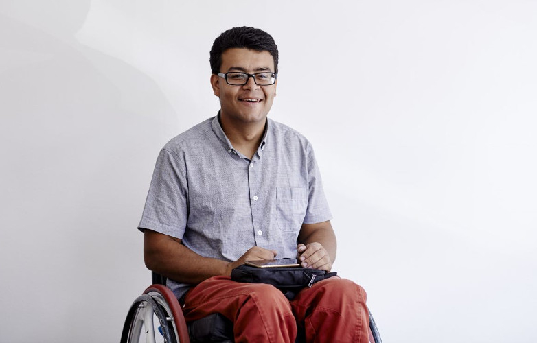 A picture of a smiling man in a wheelchair