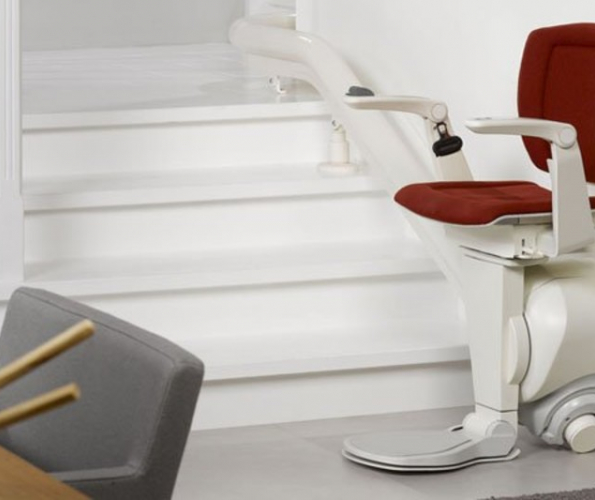 Image of an empty stairlift with a red seat cover