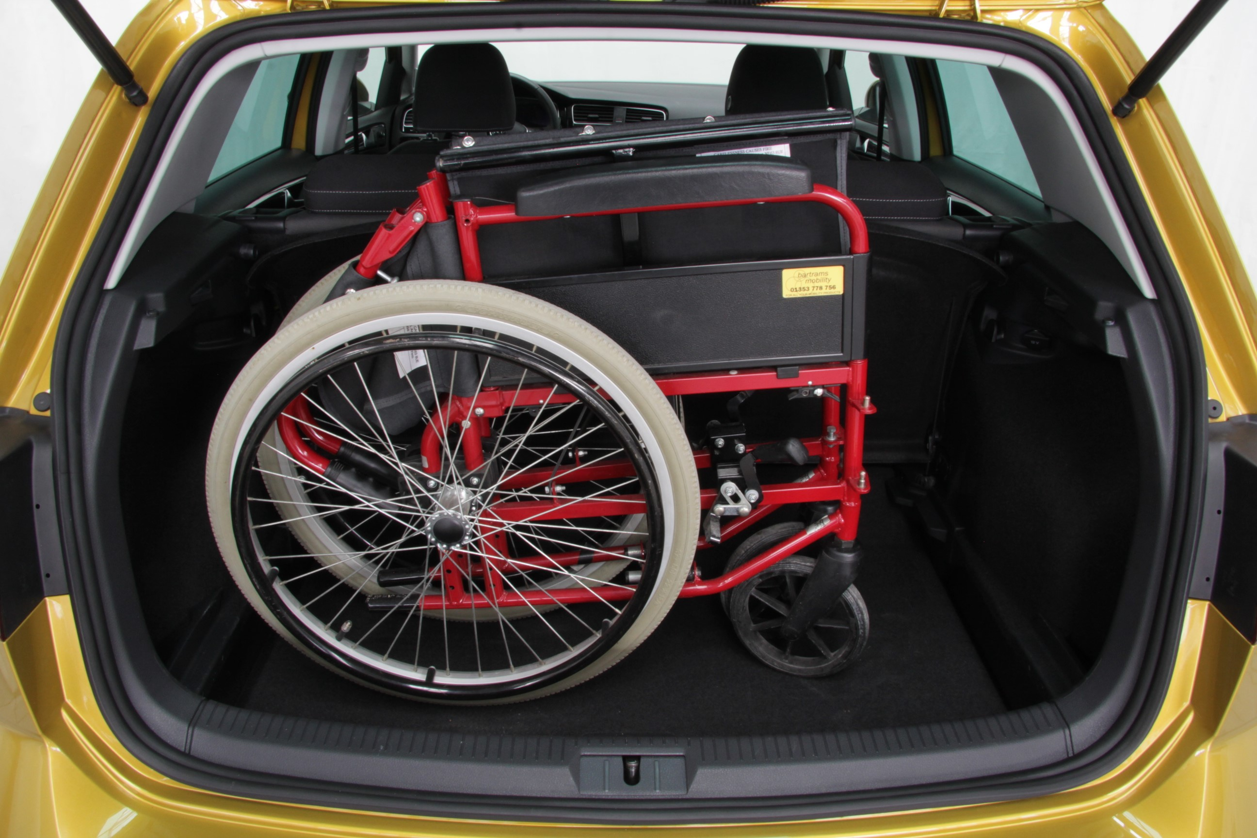 Picture of a folded wheelchair in a car boot
