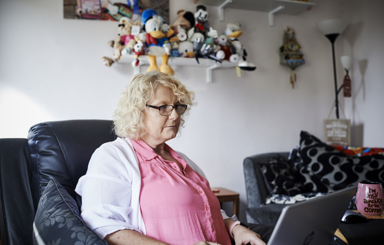 A picture of Bev, a member of the RiDC panel, using her laptop