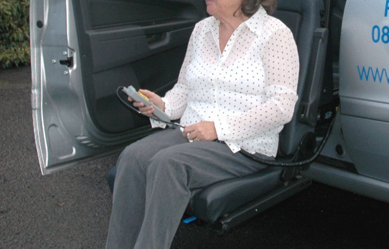 A woman sitting on a swivel seat