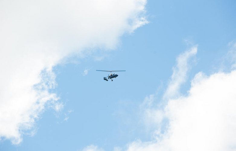 Helicopter flying in blue sky